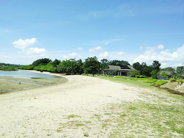 the sand in aduna beach villas