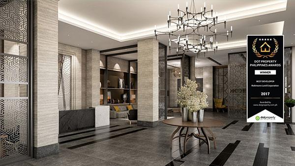 the grandiose reception and lobby area of the condo