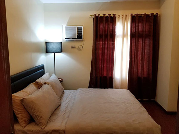 bedroom with furniture and aircon