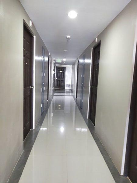 well-lighted hallway of the condominium