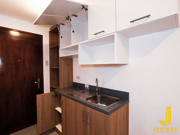 cabinets at the model unit in the condominium project