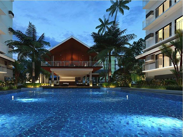 swimming pool and the clubhouse in amani grand resort residences