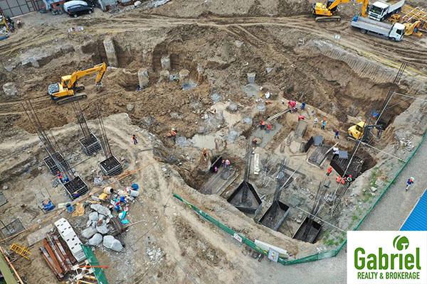 land development in arc towers condominium